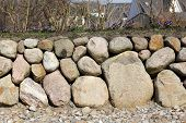 stock photo of fieldstone-wall  - The Frisian stone wall is a dry stone wall typical for Northern Germany - JPG