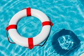 picture of crisis  - an emergency tire floating in a swimming pool - JPG