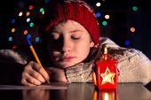 picture of letters to santa claus  - The child writes a letter to Santa Claus - JPG