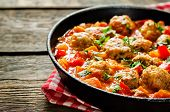 foto of meatballs  - meatballs baked with vegetables on a dark wood background - JPG
