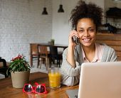 pic of people talking phone  - Close up portrait of an attractive you woman talking on phone at home