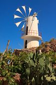 pic of windmills  - Irrigation windmills are the symbol of the Lasithi Plateau Crete Greece - JPG