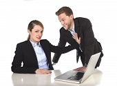 foto of inappropriate  - young attractive businesswoman suffering sexual harassment and abuse of colleague or office boss touching her at work with excessive familiarity in work relationship concept - JPG