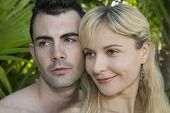 picture of adam eve  - Young couple looking away heads close together - JPG