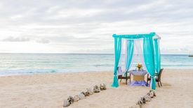 image of cabana  - wedding arch and set up on beach - JPG