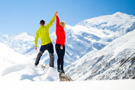 picture of winter sport  - Couple hikers man and woman success in winter mountains sport climbing - JPG