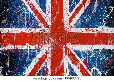 Painted Concrete Wall With Graffiti Of British Flag. Grunge Flag Of United Kingdom. Union Jack