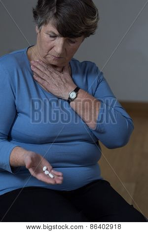 Elder Woman Taking Medicine