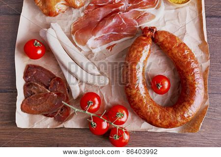 Assortment of deli meats on parchment, top view