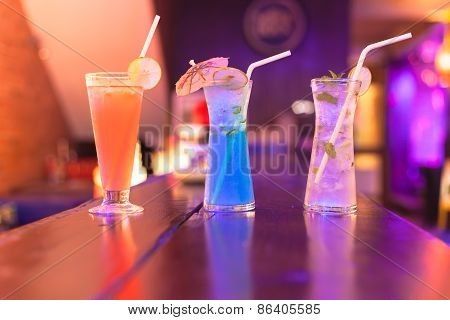 Cocktails On The Bar Counter In Night Club