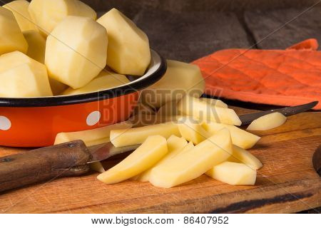 Raw Potatoes In A Vintage Enamel Bowl