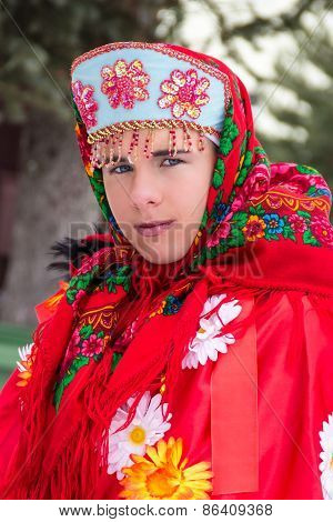 Girl in red russian folk clothes.