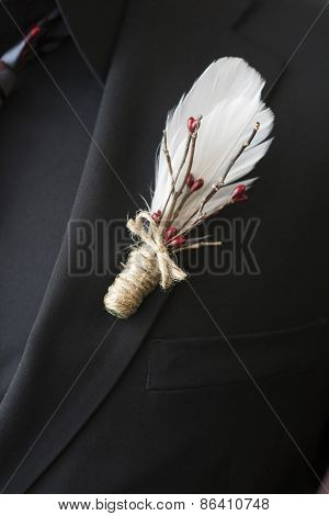 Lapel boutonniere feather