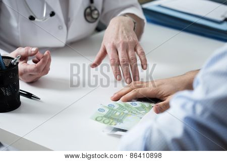 Doctor Refusing A Bribe