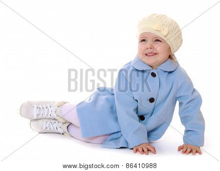 The girl in skates sitting on the floor