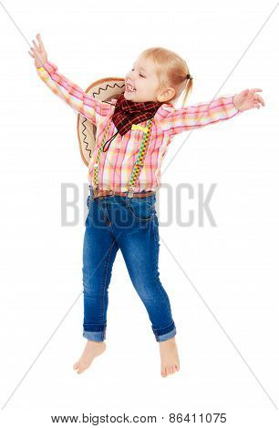 Cheerful girl in clothes cowboy jumps for joy
