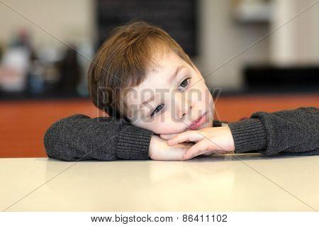 Boy Waiting For Dessert