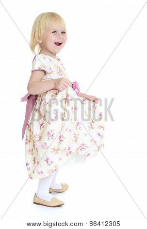 Little happy girl in a bright dress