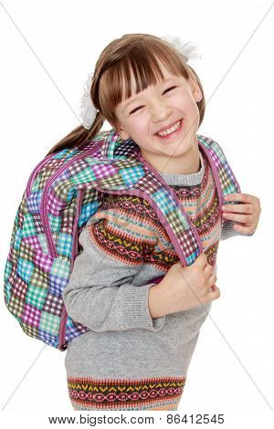 Cheerful girl with a backpack on his back