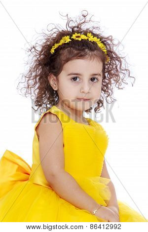 Portrait of a curly-haired girl with yellow flowers