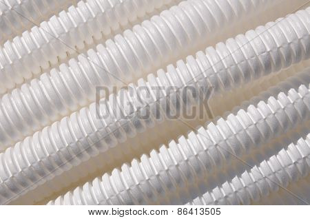 White plastic corrugated pipe