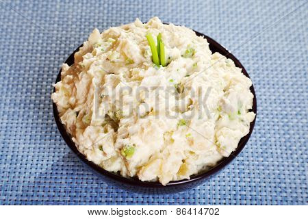 Patato And Avocado Mash Garnished With Mayonnaise
