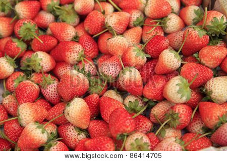 fresh red strawberry as a background