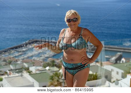 Aged Woman On Los Gigantes Coast Landscape Background, Tenerife, Canary.