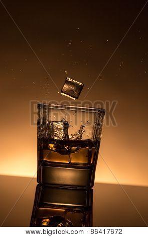Splashing Whiskey With Ice Cubes