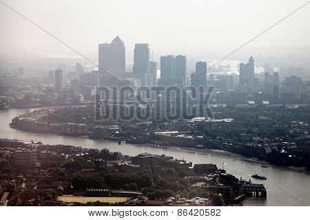 Misty cityscape of the River Thames and London Docklands