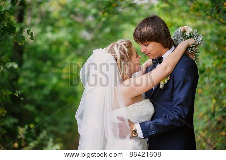 Bride And Groom For A Walk In The Park