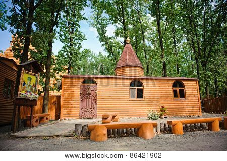 Wooden Orthodox Church On A Background Of Trees