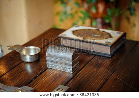 Cross And Bible On The Wooden Table