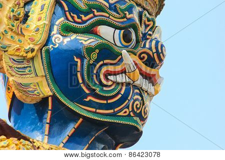 Closeup Face Giant Statue At Temple Of The Emerald Buddha