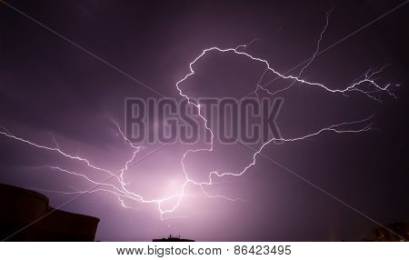 Lightning above the town buildings