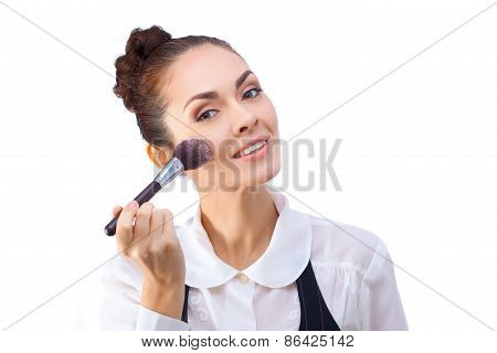 Woman with makeup brushes.  All isolated on white background.