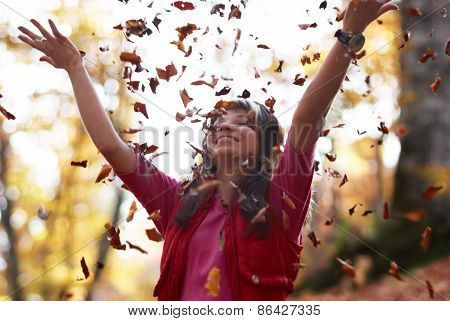 Beautiful Girl With Falling Leaves