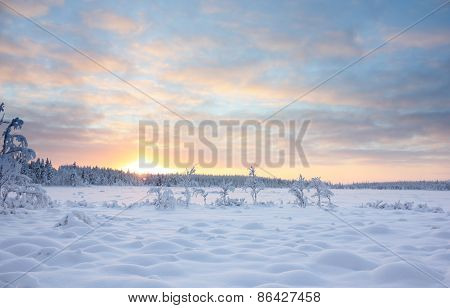 Sunset Over Snowy Lake