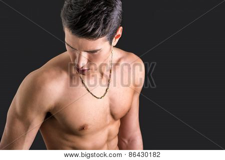 Handsome, Fit Young Man Shirtless, Against Dark Background