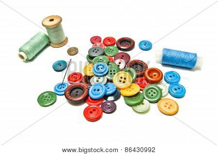 Many Plastic Buttons And Spools Of Thread