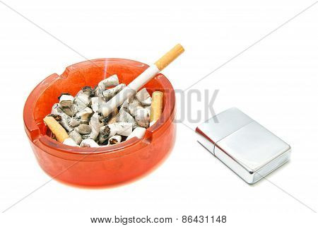 Single Cigarette In Ashtray And Silver Lighter