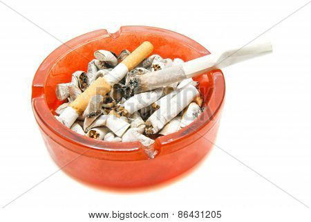 Cigarette In Ashtray With Butts