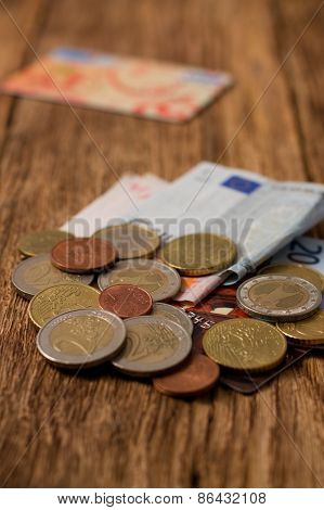 Pile Of Euro Coins, Bills And Credit Cards