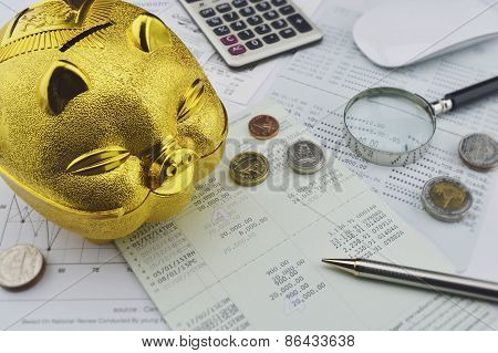 Gold Piggy Bank With Coin On Saving Account Book