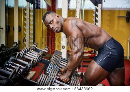 Handsome Black Male Bodybuilder Resting After Workout In Gym