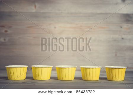 Paper muffin cups isolated on white background