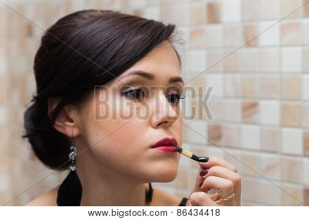 Beautiful woman doing makeup.