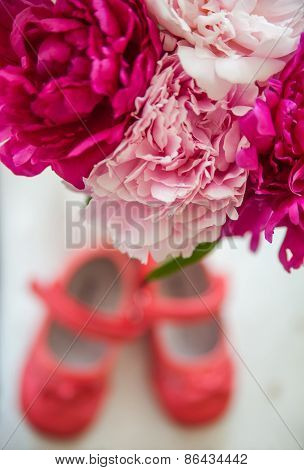 Bouquet Of Spring Flowers And Children's Shoes