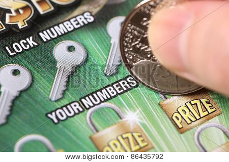 Coquitlam BC Canada - March 21, 2015 : Woman scratching lottery tickets. The British Columbia Lottery Corporation has provided government sanctioned lottery games in British Columbia since 1985.