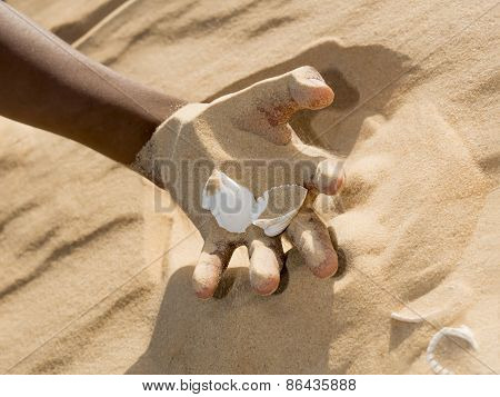 Man holding some sand in the hand
